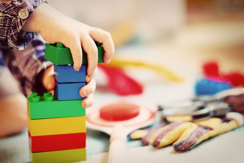 Child with building blocks