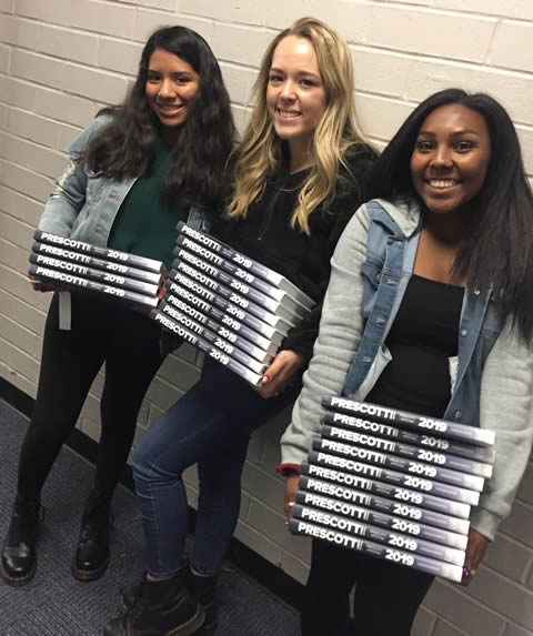 Students distributing yearbooks